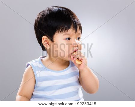 Asian baby boy eat with his finger food