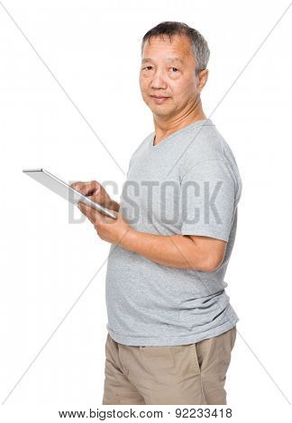 Mature man use of tablet computer