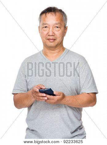 Asian old man use of mobile phone