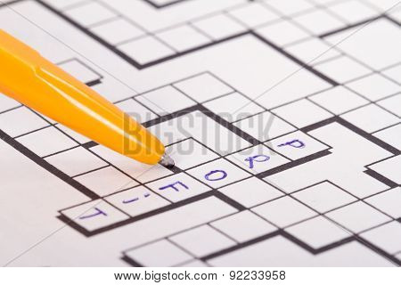 Blank Crossword Puzzle With Pen And Profit Text