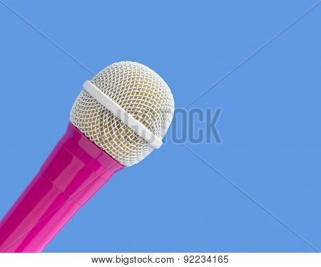 Pink and white microphone on a blue background
