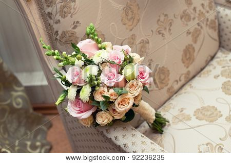 Beautiful wedding colorful nosegay on chair