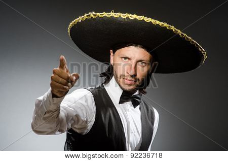 Mexican man wears sombrero isolated on white