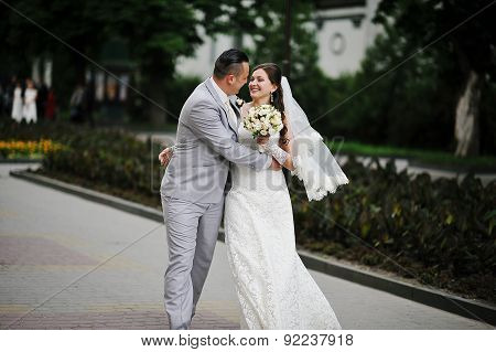 Just Married Wedding Couple Walking At The Streets Of Town