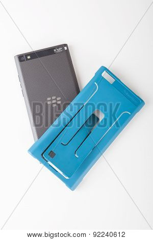 BlackBerry Leap smartphone and blue phone case