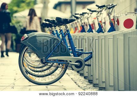 row of bicycles for city bike hire on a street