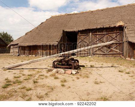 Rural barn and a treadmill.