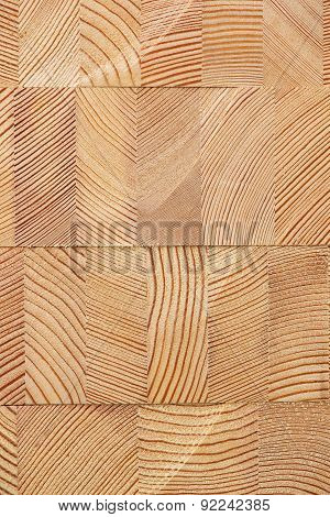 Background with many glued larch wooden blocks.