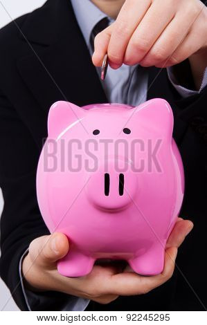 Business Woman And Piggy Bank