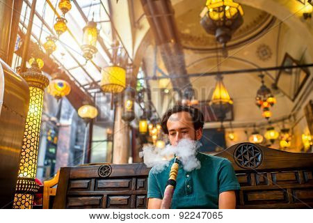 Man smoking turkish hookah