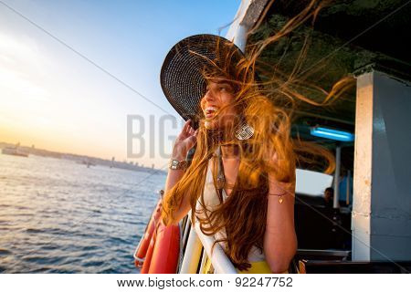 Woman enjoying the sea from ferry boat