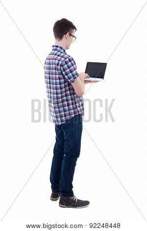 Back View Of Teenage Boy Holding Laptop With Blank Screen Isolated On White
