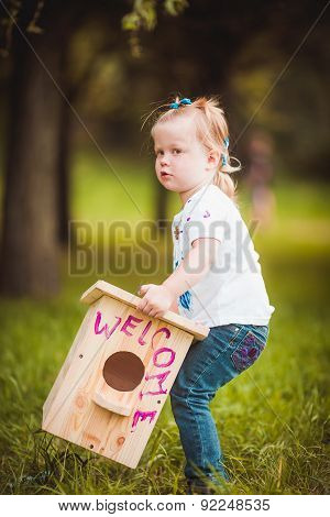 Little girl with nesting box