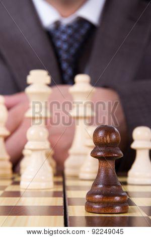 Businessman Focused On Pawn