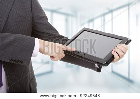 businessman showing touch pad, close up shot on tablet pc, at the office