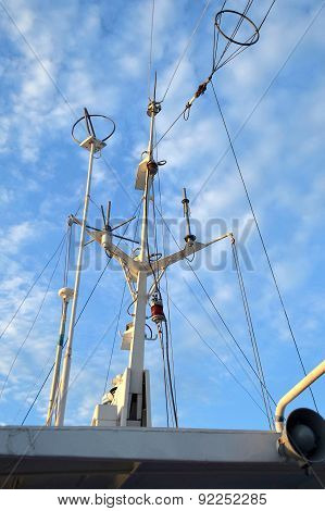 Branched antenna wire of the ship against blue sky
