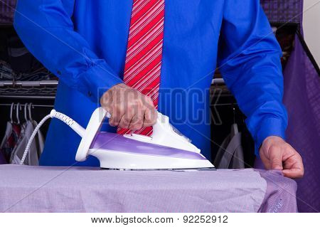 Businessman Ironing Clothes