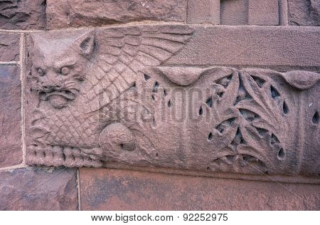 carved detail of cat with wings