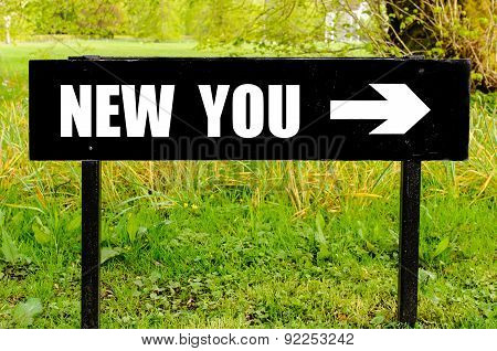 New You Written On Directional Black Metal Sign