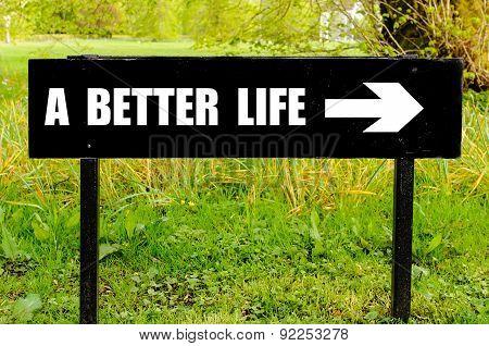 A Better Life Written On Directional Black Metal Sign