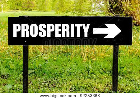 Prosperity Written On Directional Black Metal Sign