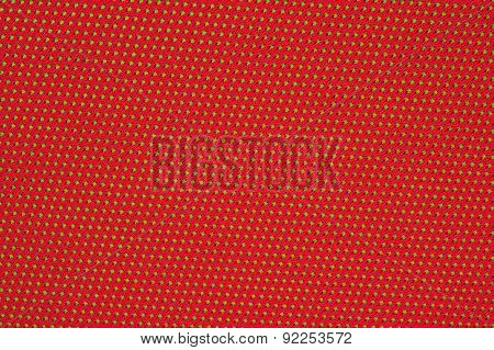 Red Nonwoven Fabric On A Green