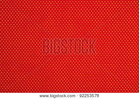 Red Nonwoven Fabric On A Yellow