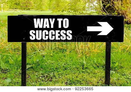 Way To Success Written On Directional Black Metal Sign