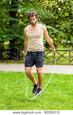 Young athlete jumping rope outdoor