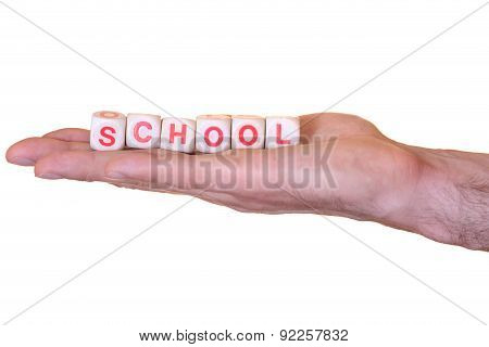 School Written With Wooden Dice On A Hand, Isolated On White Background