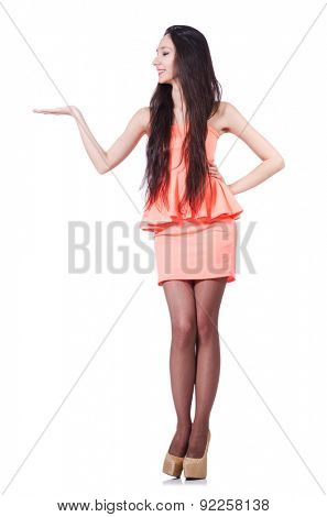 Young girl with brown hairs in short dress holding isolated on white