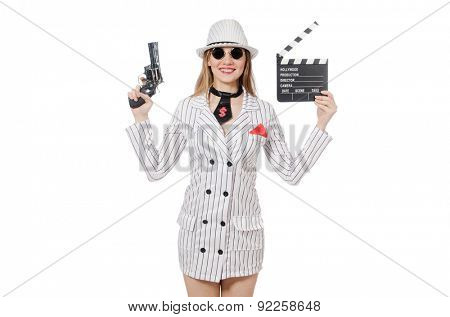 Beautiful girl holding hand gun and clapperboard isolated on white