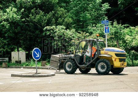 Tractor Carrying Metallic Fence Supports