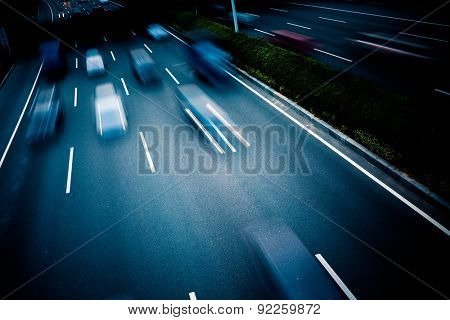 cars through the city at night.