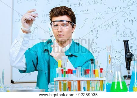 Doctor holding a syringe. Bacteriological laboratory work. Vaccinations.