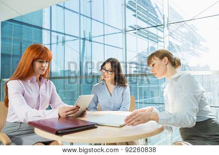 Businesswomen using digital tablet in office