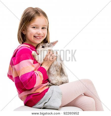cute  girl in a crimson sweater  with baby rabbit isolated over white background close-up
