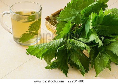 The Broth Nettle And Fresh Leaves In A Basket