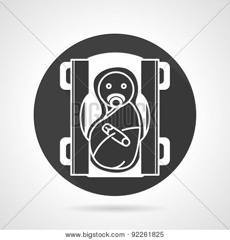 Swaddled baby black round vector icon
