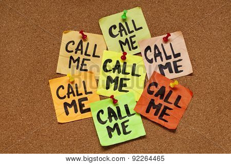 call me - several sticky notes on cork bulletin board with a reminder