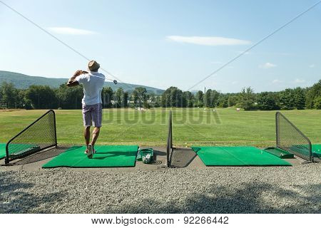 Golf at the Driving Range