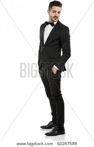 Handsome young man wearing a suit and smiling, isolated on white background