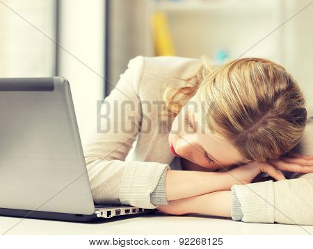 indoor picture of bored and tired woman sleeping on the table