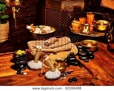 Spa still life with herbal ball and group black stones.