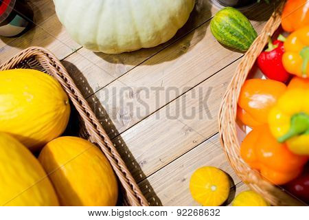 sale, farming, agriculture and eco food concept - ripe vegetables in baskets on table at grocery market or farm