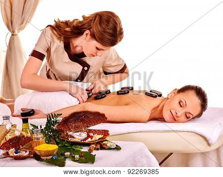 Young beauty woman getting spa lastone therapy isolated.