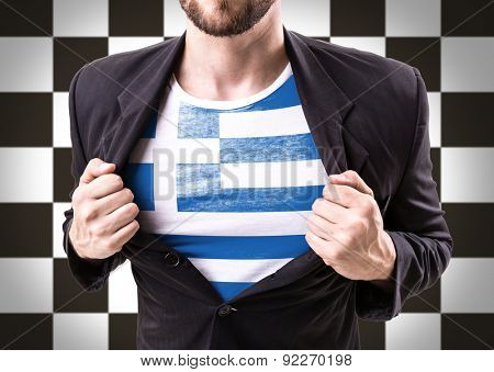 Businessman stretching suit with Greece flag on checkered background