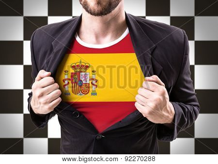 Businessman stretching suit with Spain flag on checkered background