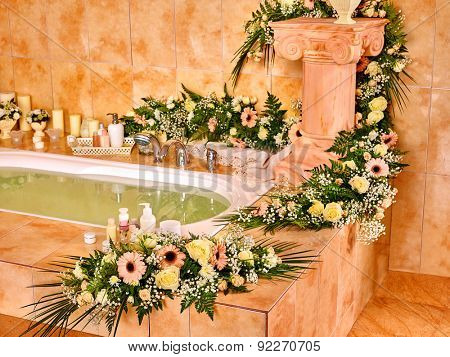 Home bathroom interior with flower and bubble bath.