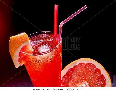 Grapefruit cocktail with umbrella  in highball glass . Cocktail card 28